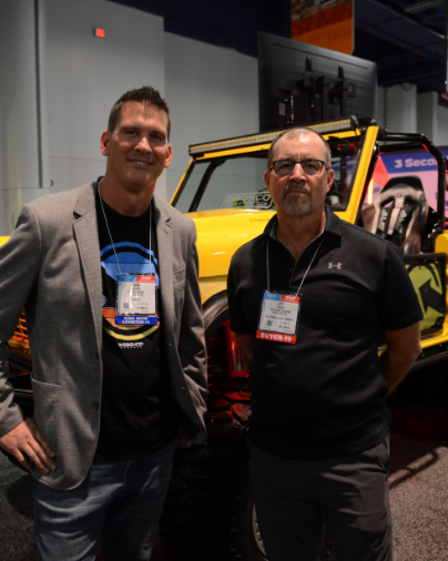 The Owner with Jeff from Bronco Graveyard in front of the yellow bronco at SEMA